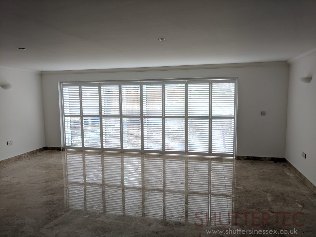 white tracked shutters