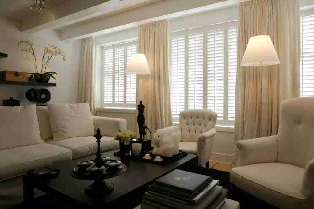 pairing curtains with shutters looks great and has benefits