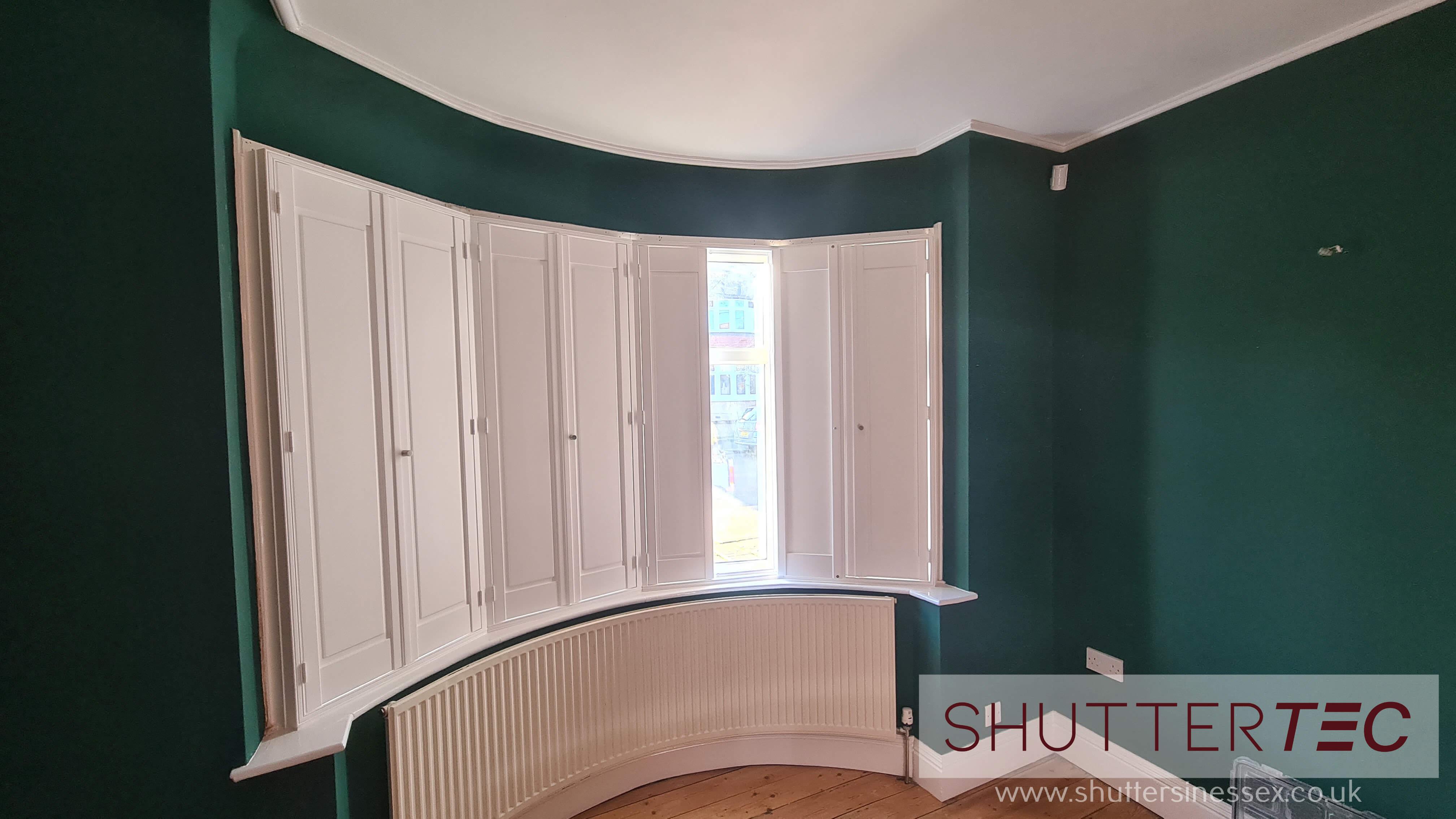 Solid panel shutter for bedroom window