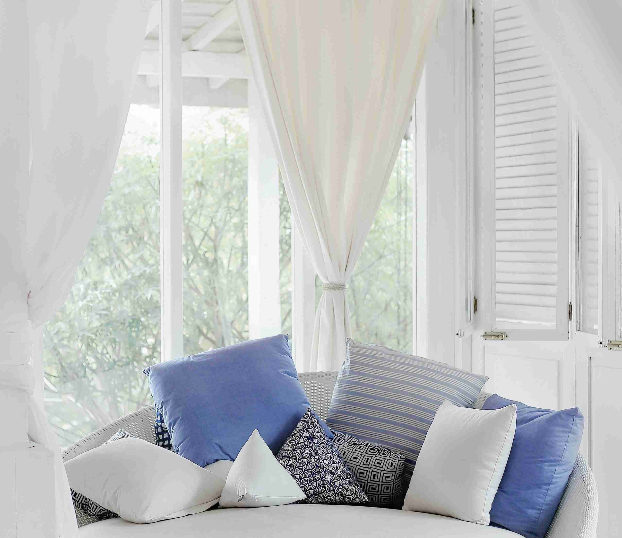 title graphic for Shuttertec blog about choosing shutters or curtains
