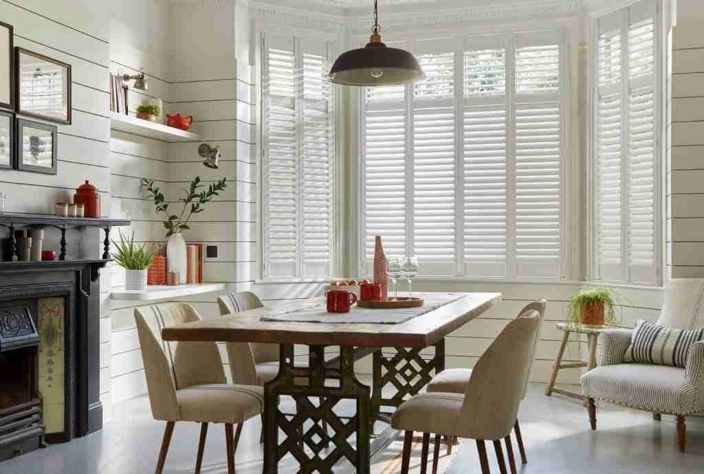 table and chairs with shutters in the background depicting shutters in London