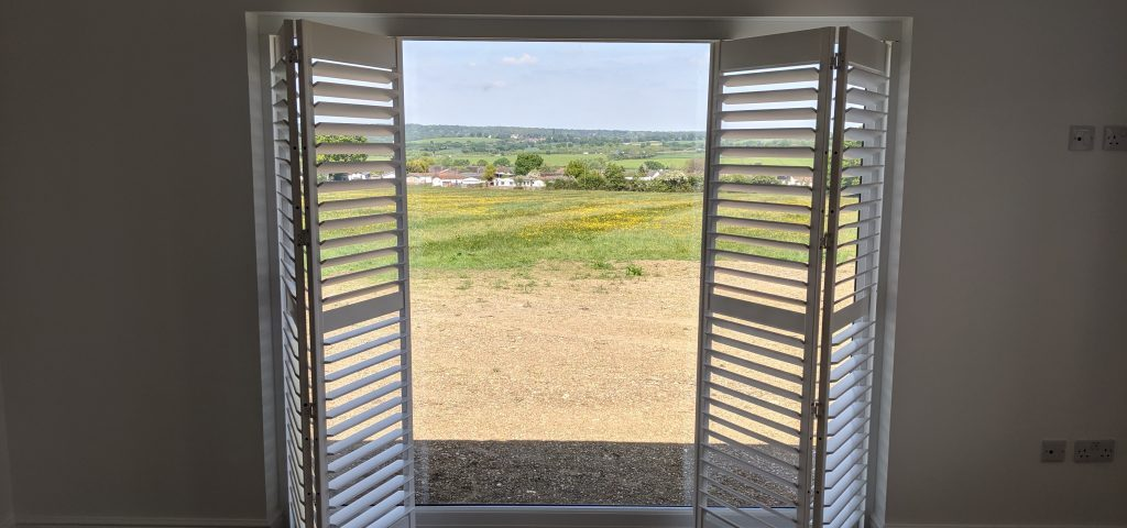Features image for blog entitled how to choose the right shutters for your Essex barn